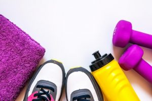 towel, gym shoes, drink bottle and weights