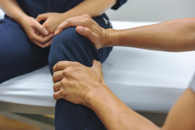 Physical therapists are checking knee injuries for patient. medical and healthcare concept Premium Photo