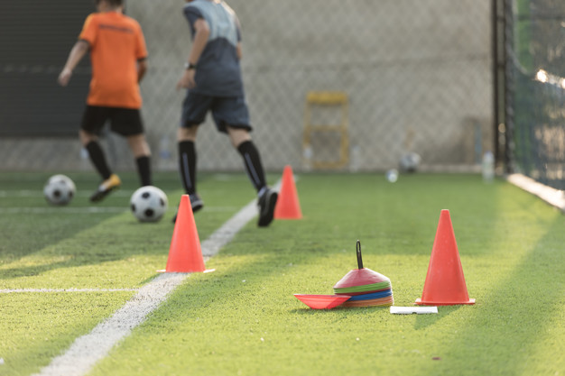 Soccer training equipments on field Premium Photo